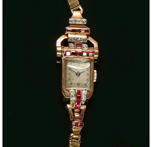 A ruby and diamond wristwatch