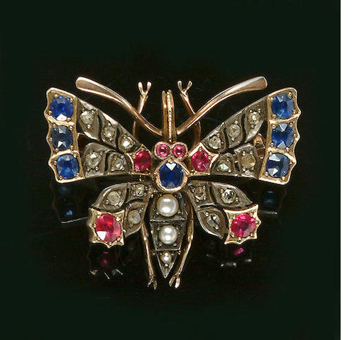A late Victorian multi gemset butterfly brooch,