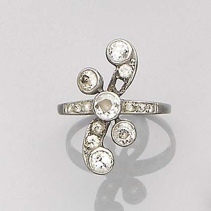 A diamond set scroll ring