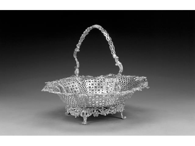 An early George III silver oval swing-handled cake basket, by Abraham Portal, London 1761,