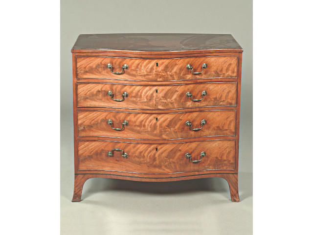 A George III style mahogany serpentine chest,