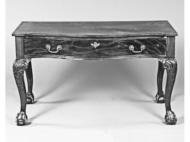 A mahogany Irish style serpentine side table,