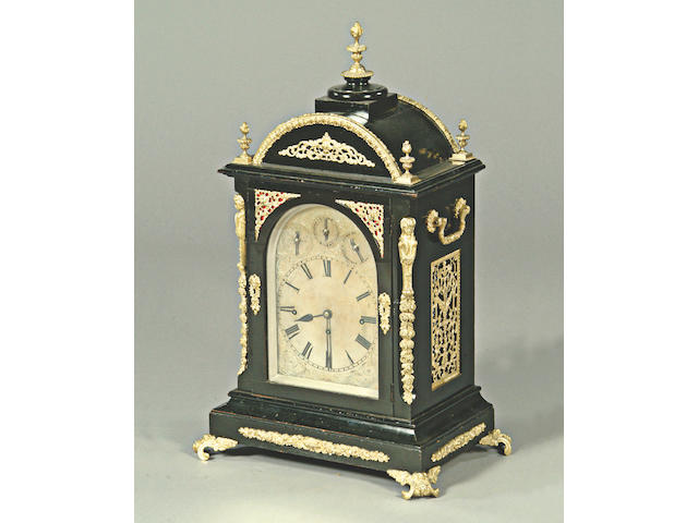 A mid Victorian ebonised and gilt metal bracket clock,