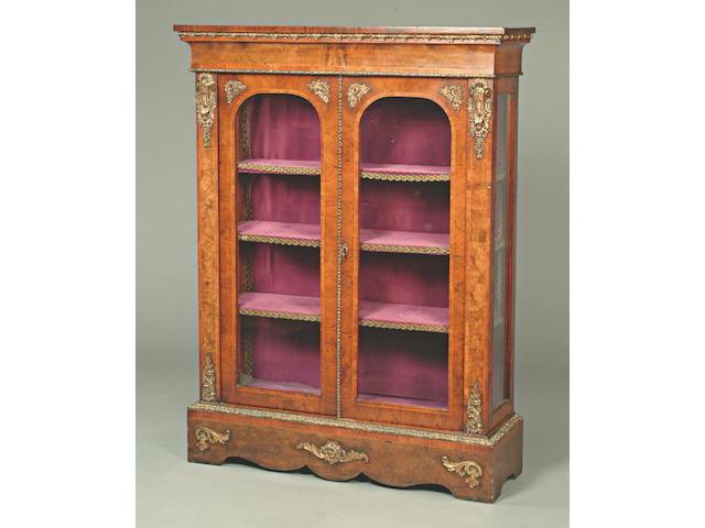 A mid 19th Century French crossbanded walnut and boxwood lined display cabinet,