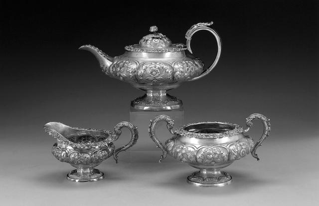 A George IV three piece silver tea service, by William Hattersley, London 1828,
