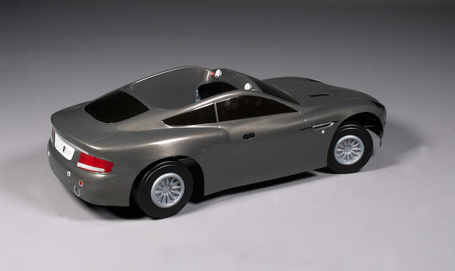 A rare 007-Up promotional Aston Martin Vanquish pedal car, American,