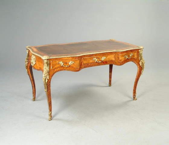 A mid 19th century kingwood tulipwood and gilt brass mounted bureau plat in the Louis XV taste