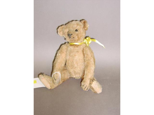 A small Steiff teddy bear, circa 1909