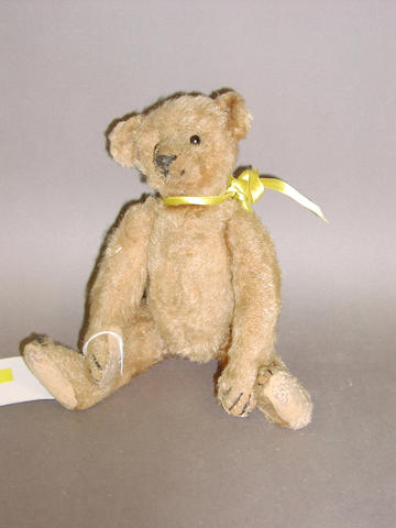 A small Steiff teddy bear, circa 1909