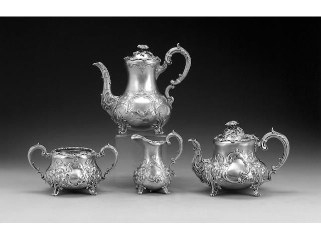 A Victorian three piece silver tea service and almost matching coffee pot, all by D. & C. Houlle, the tea service London 1858, the coffee pot London 1862,