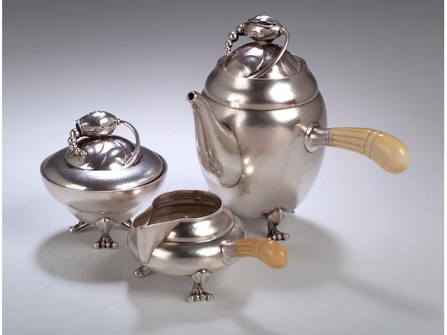 Georg Jensen, A silver three piece cafe au lait set,