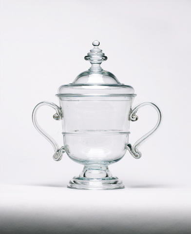 An important glass handled cup and cover circa 1715-30