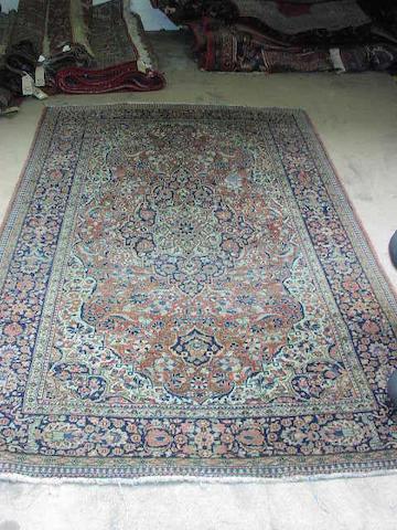 A Kashan rug, 1.33 x 2.16m