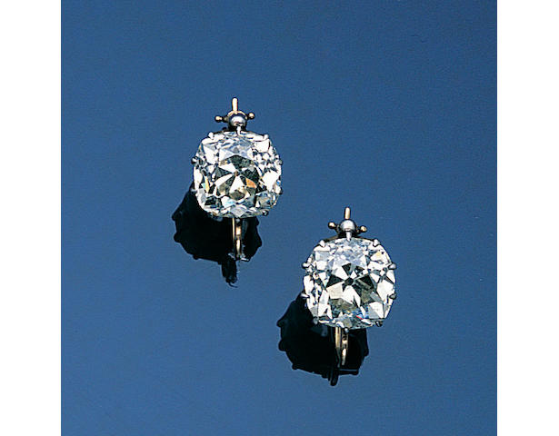 A pair of late Victorian diamond single-stone earpendants,
