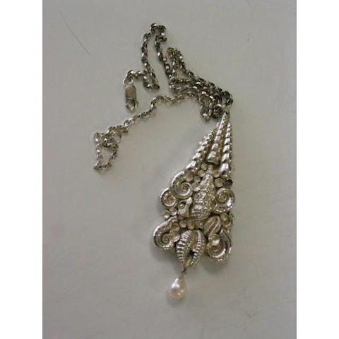 Jocelyn Burton A silver pendant,