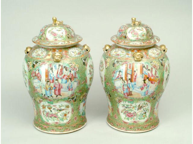 A pair of Canton Famille Rose vases and covers