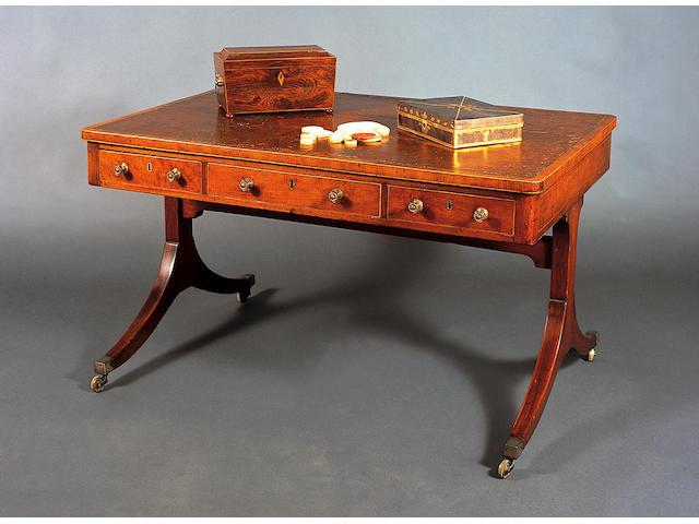 An early 19th Century kingwood and boxwood line edged tea caddy of sarcophagus form,