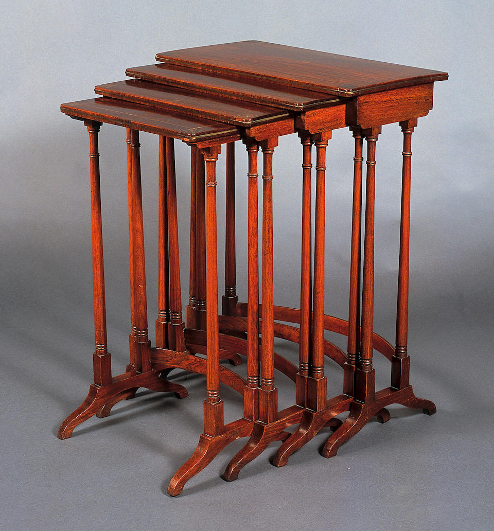 A Regency rosewood and brass line inlaid quartetto nest of occasional tables,