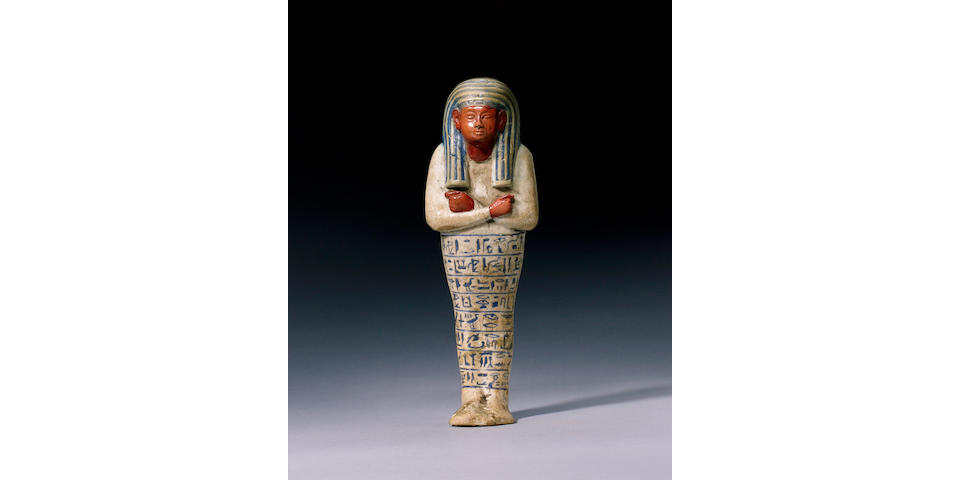 An Egyptian white faience shabti of Ay