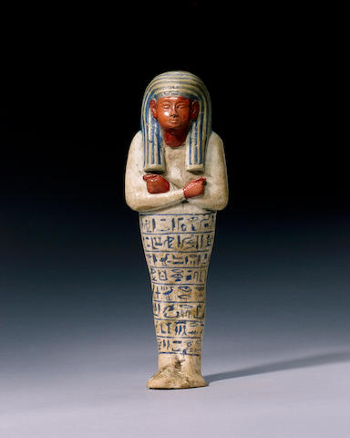 An Egyptian white glazed composition shabti of Ay