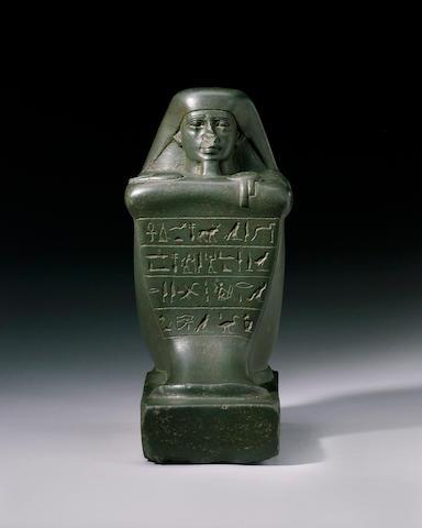 An Egyptian basalt block statue of General Pakyr(er)