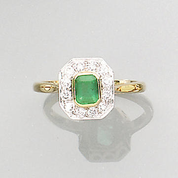 An emerald and diamond cluster ring,