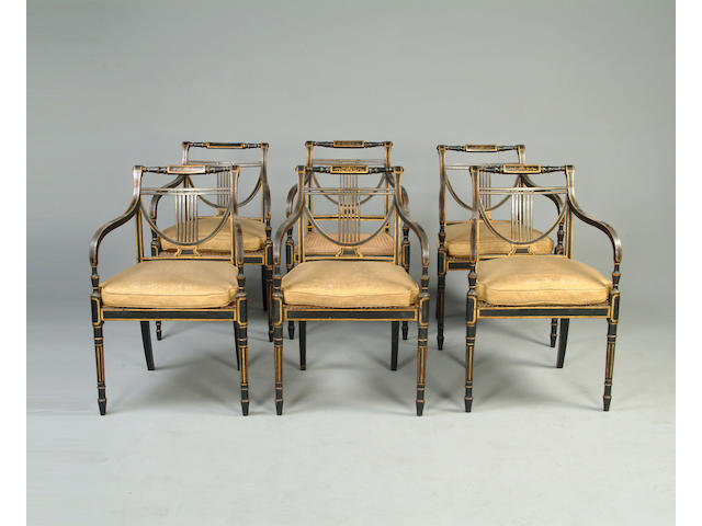 A set of six black and gold decorated Open Armchairs in the Regency style,
