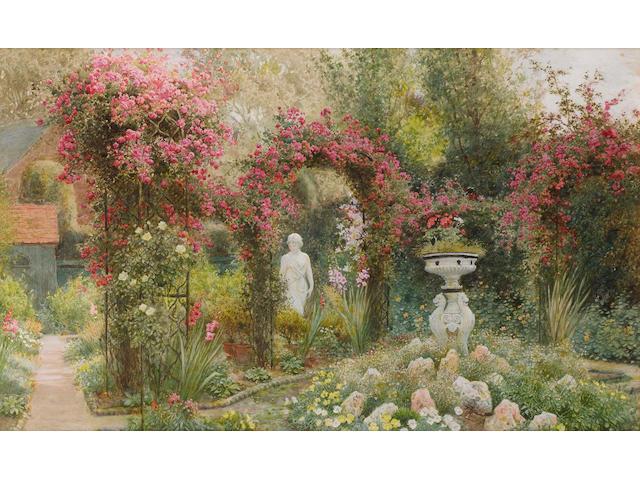 Arthur Claude Strachan (British, 1865-1932) A statue in a romantic garden 27 x 45 cm. (10 3/4 x 17 3/4 in.)