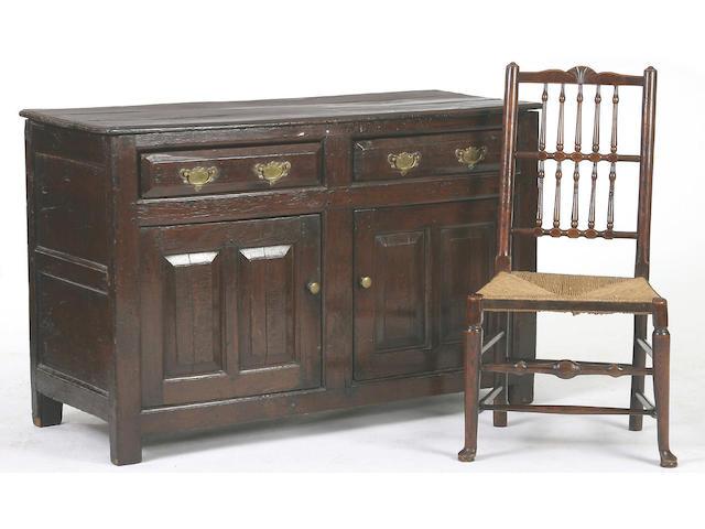 A mid 18th Century oak low dresser,