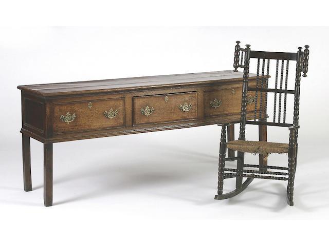 A late 18th Century oak low dresser,