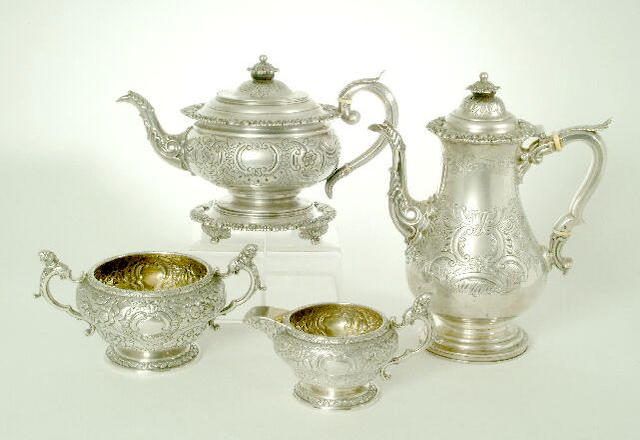 A George III matched five-piece tea and coffee service, the coffee pot, teapot and teapot stand by Samuel and Charles Younge, Sheffield 1817/1818, the sugar basin and milk jug by Samuel Hougham, Solomon Royes and John East Dix, London 1818,
