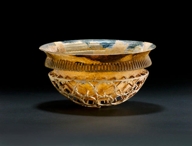 A Roman iridescent colourless glass cage cup