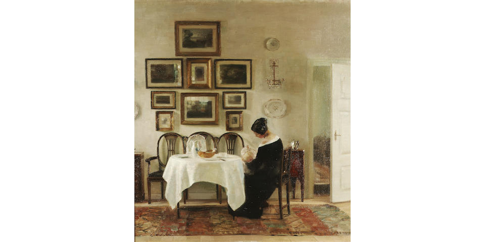 Carl Vilhelm Holsøe (Danish 1863-1935) Mother and child in a dining room interior 75.5 x 68.5 cm. (29 3/4 x 27 in.)