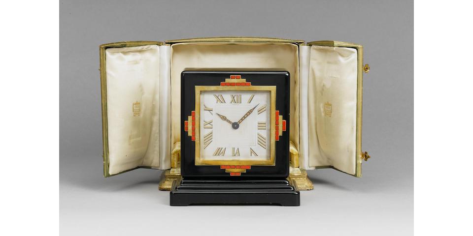 Cartier/European Watch & Clock Co. A rare art deco black laquer of China table clock with its original box circa 1930