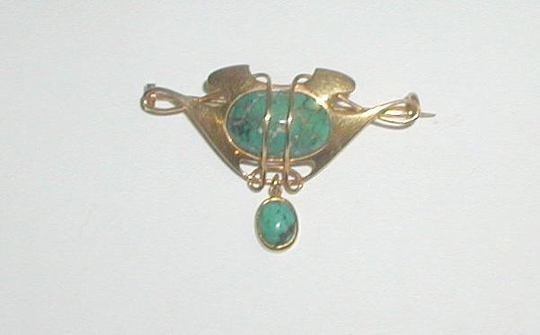 A Murrle Bennett brooch,