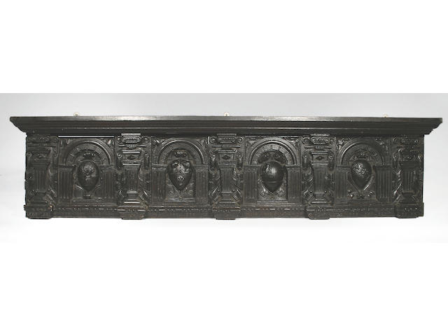 Four 17th Century carved oak armorial panels,