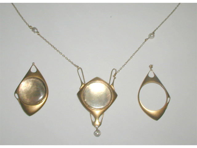 A gold and seed pearl pendant, probably by Archibald Knox, retailed by Liberty & Co.,