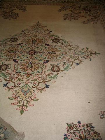 A Tabriz carpet North West Persia, 410cm x 327cm