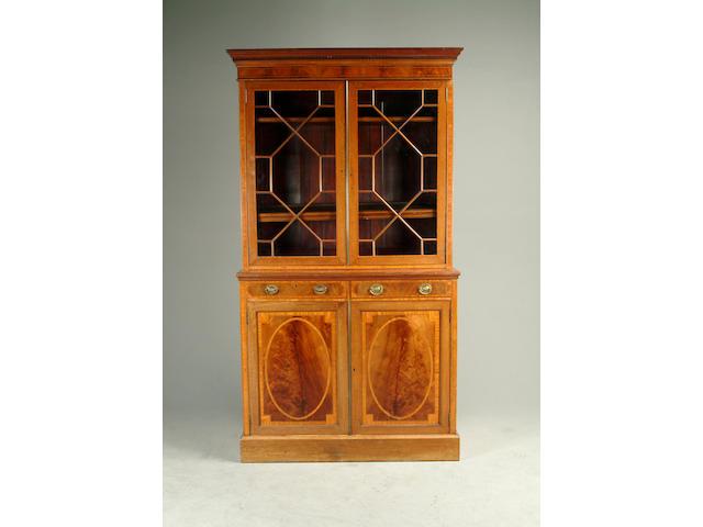 An Edwardian mahogany and satinwood banded bookcase
