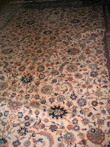 A Kashan carpet Central Persia, 350cm x 370cm signature in each corner