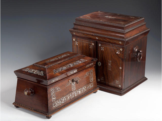 A Victorian rosewood and mother of pearl inlaid sarcophagus shaped Tea Caddy,