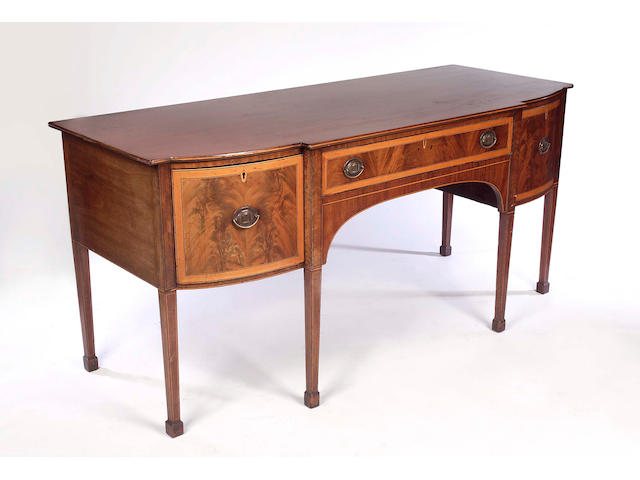 A Regency mahogany and satinwood banded breakfront Sideboard,
