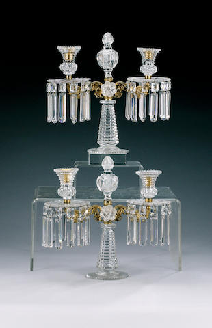 A pair of gilt metal mounted twin branch cut lustre candelabrum,