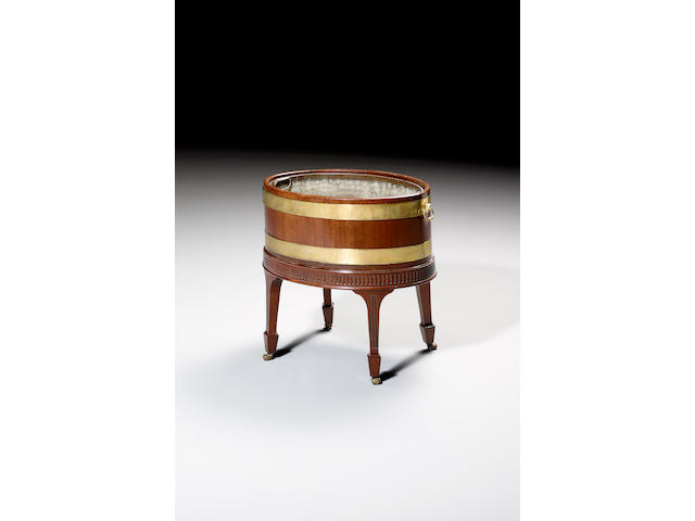A George III mahogany and brass bound Cellarette,on a later stand