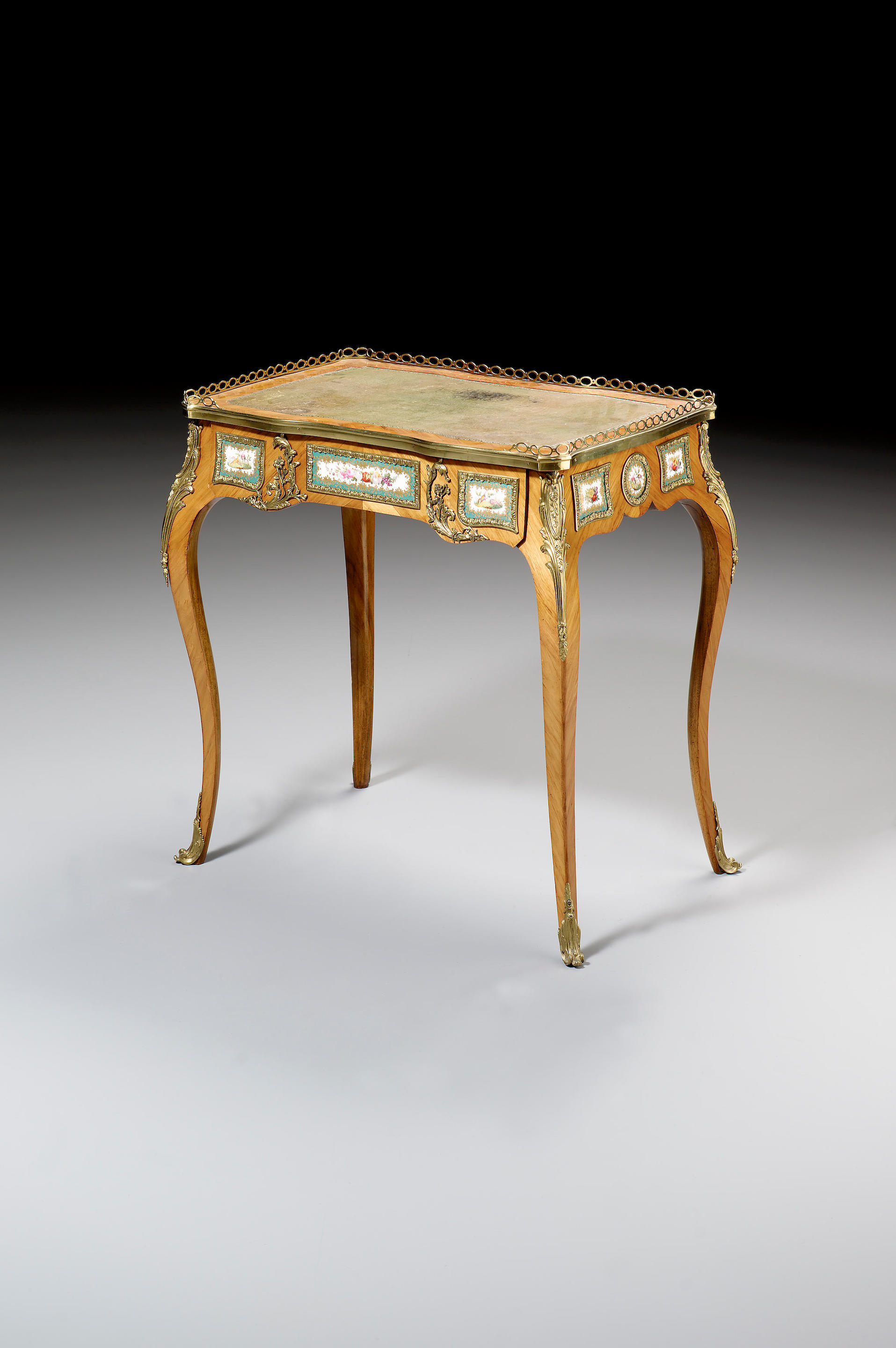 An early Victorian Louis XV style kingwood and gilt metal mounted Table à...