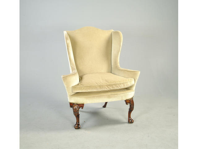 A Queen Anne style walnut framed wing back armchair