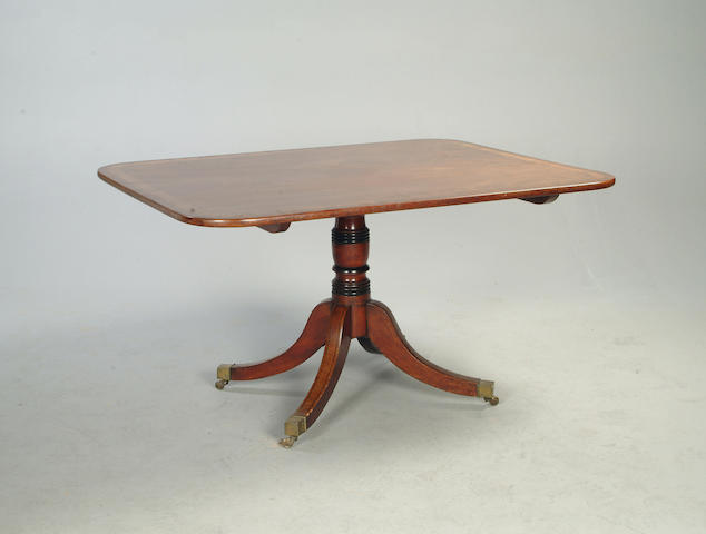 A late George III  mahogany and rosewood crossbanded  breakfast table