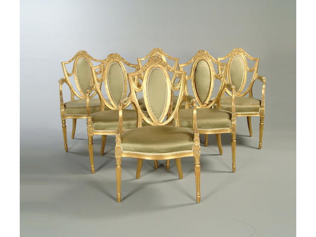 A set of six late George III carved giltwood salon chairs