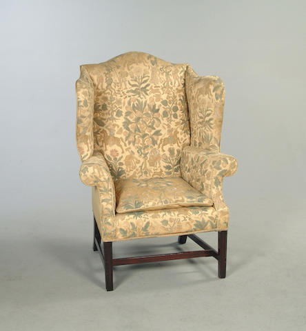 A George III mahogany framed  wingback arm chair