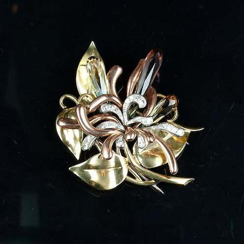 A tourmaline and diamond flower brooch